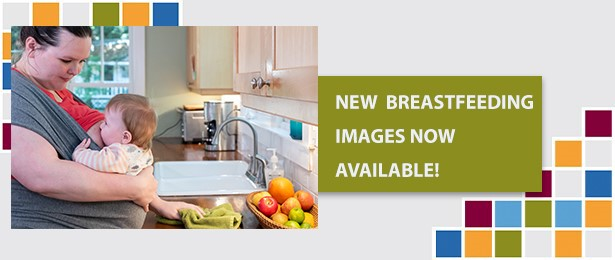 The photo portrays a mother breastfeeding her baby while standing at kitchen sink.